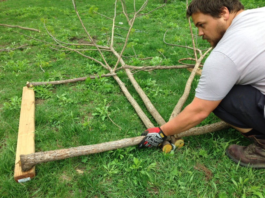 How to build a rustic garden gate from scratch (for cheap!) using sticks and small trees. The ultimate repurposing to build a garden or orchard door!   Whole-Fed Homestead