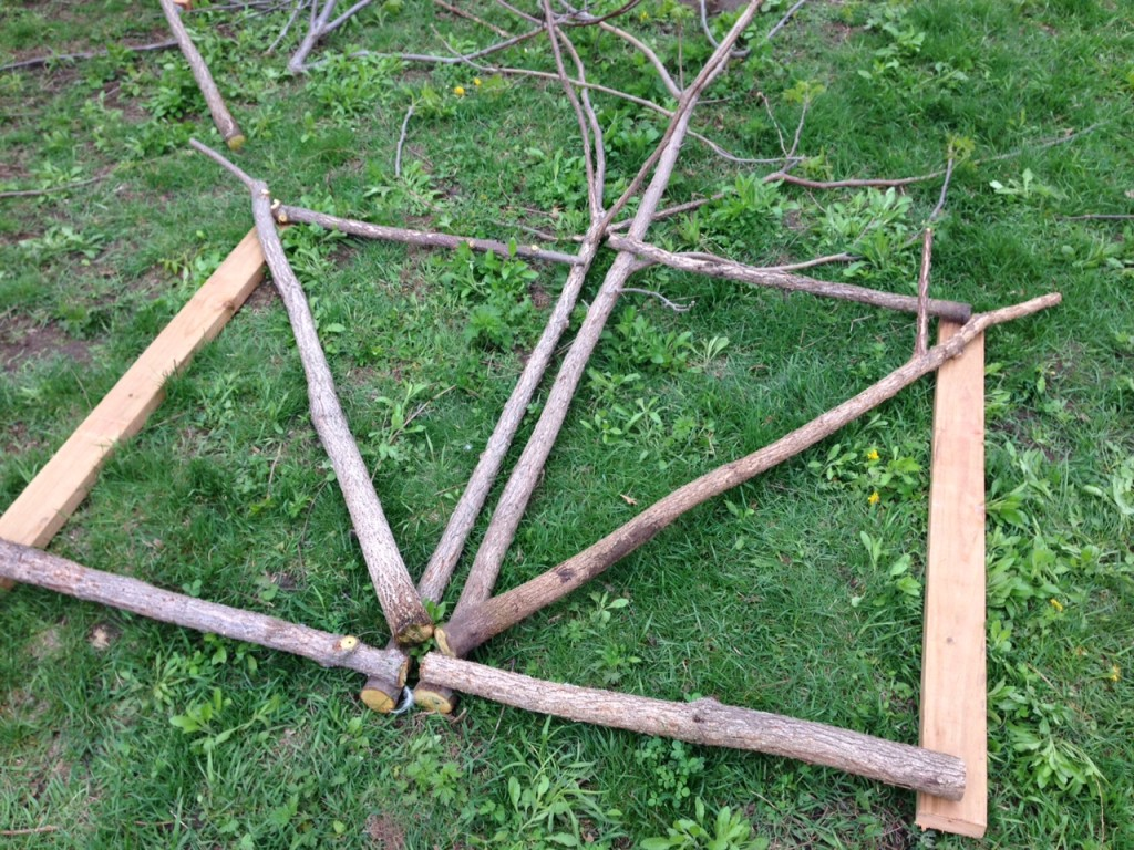How to build a rustic garden gate from scratch (for cheap!) using sticks and small trees. The ultimate repurposing to build a garden or orchard door! | Whole-Fed Homestead